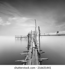 """Long exposure, Black and white image of """"langgai"""" , the traditional fishing medium at Malaysia . (Image has certain noise and soft focus )"""