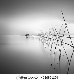 "Long exposure black and white image of ""langgai"" , the traditional fishing medium at Malaysia ."