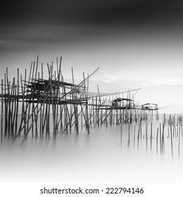 "Long exposure and black and white image of ""langgai""  , the traditional fishing medium at Malaysia ."