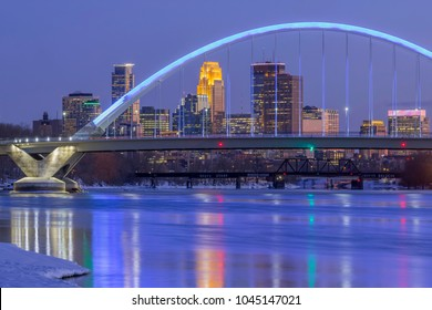 A Long Exposure of the Blue Lowry Bridge Compressed with the Minneapolis Skyline during a Winter Twilight Hour