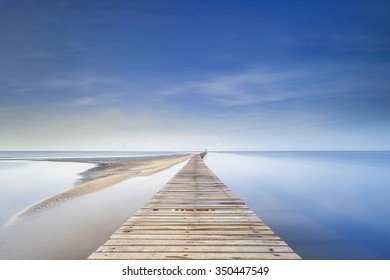 A long exposure at blue sky of a jetty in Australia