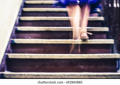 Long exposure blurry shot of woman legs climbing stairs