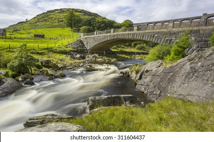 Long exposure of bridge with Claerwen Dam behind, Elan Valley, Wales, UK