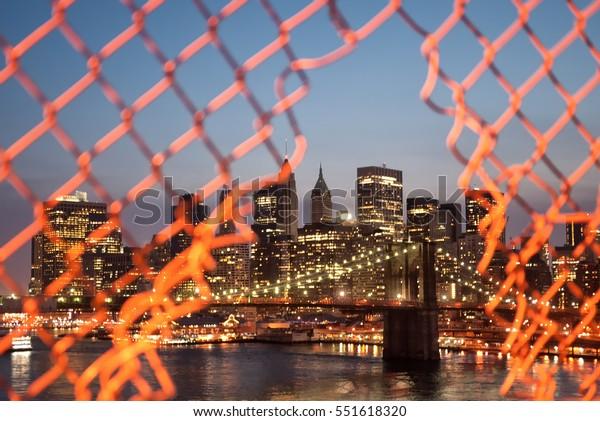 Long exposure of Brooklyn Bridge and downtown Manhattan in New York City