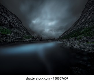 Long exposure capture of river flowing through a mountain pass, Norway