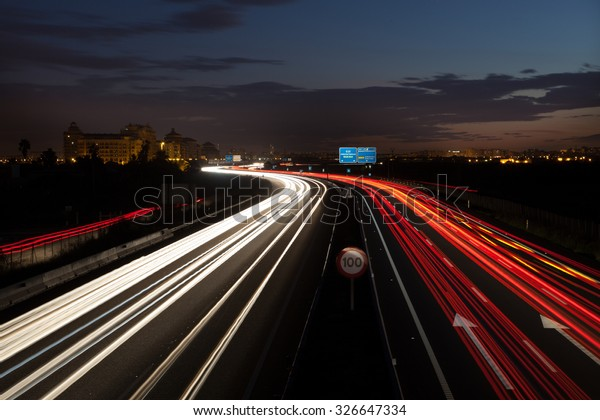 Long exposure of cars passing by Highway in Valencia, Spain .