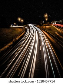 Long exposure of cars passing with stars overhead on a rainy winter evening in Jackson, MS