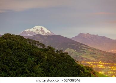 Long Exposure Of Chimborazo Volcano And Altar Volcano Illuminated By The Moonlight, Ecuador, South America