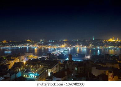 Long exposure cityscape of Istanbul at a night. Galata bridge on Golden Horn gulf. Wonderful romantic old town at Sea of Marmara. Bright light of street lighting and various ships. Istanbul. Turkey.