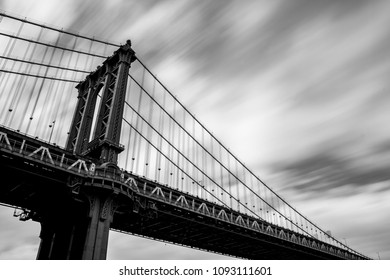 Long exposure of clouds moving over the Manhattan Bridge