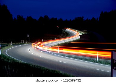 Long exposure of a couple of driving car on the street