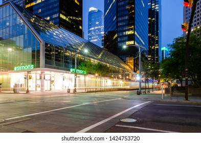 Long exposure of a CTrain travelling on 7th Avenue outside the La Maison Simons store in Calgary, Alberta, Canada on the 30th July 2018