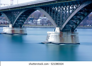 Long Exposure Daylight Exterior Picture of Peace Bridge crossing the Niagara River from Buffalo, New York to Fort, Erie, Canada in Ontario.
