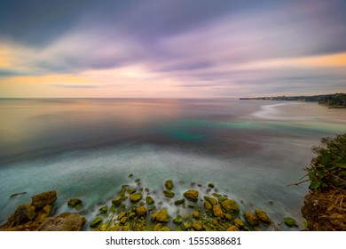 Long exposure dramatic tropical sea and sky sunset, Longexposure shot Colored sky over ocean coast on sunset time background.