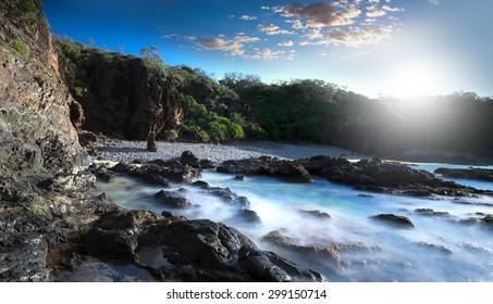 Long Exposure During Sunrise With a Misty Ocean Coastline, a Large Cliff and Vegetation, Noosa National Park, Noosa Heads, Sunshine Coast, Australia