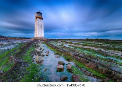 A long exposure at dusk of the lighthouse at Southerness on the Galloway coast in Scotland