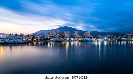 Long exposure of Estepona Port and beach taken at sunset /golden hour on the Costa del Sol in Spain.