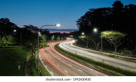 Long exposure of evening peak hour traffic along pan island expressway in Singapore