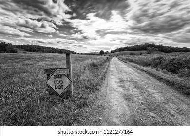 Long exposure farm road with dead end sign