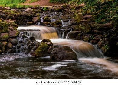Long exposure of fast moving water in Dartmoor National Park
