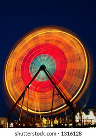 Long exposure of a ferris wheel at a carnival.