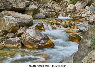 A long exposure of a fresh water stream in the himalayan mountains on a cold summer afternoon