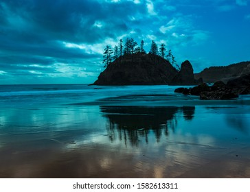 Long exposure, Grandmother Rock, Trinidad State Beach in Triidad, in the blue hour, in Northern California, USA, l featuring predominantly blue colors and some clouds