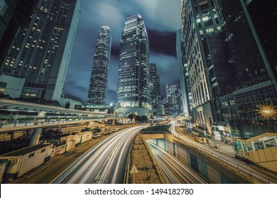 Long exposure of Hong Kong Cityscape skyscaper which have light traffic transportation from car or bus on Central Business District around IFC building, Hong Kong