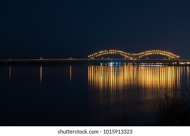 Long exposure of the I-40 bridge at night.