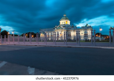 The long exposure image of Ananta Samakhom Throne Hall and the cloudy sky in the rainy evening with empty road in the foreground.