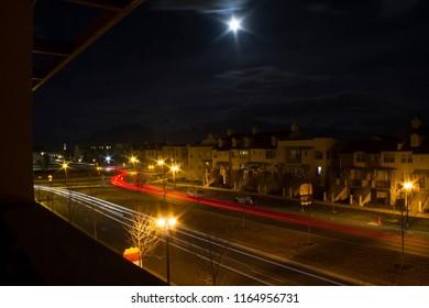 Long exposure image of car trails at night in South Jordan, Utah, USA.