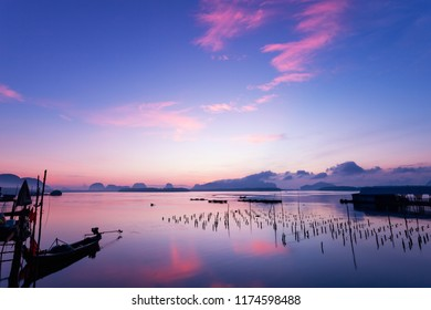 Long exposure image of Dramatic color sky seascape with reflection in sunset or sunrise scenery nature for background