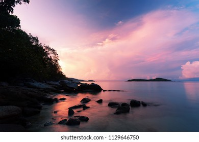 Long exposure image of Dramatic sky and wave seascape with rock in sunset scenery background,beautiful landscape for nature background or wallpaper