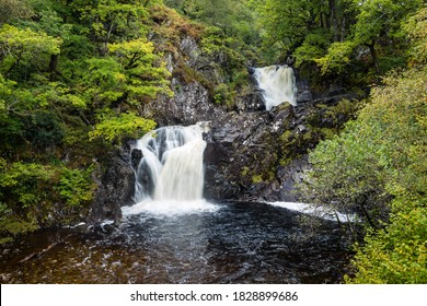 Long exposure image of Eas Chia-Aig waterfalls in Glen Chia-Aig near Achnacarry, Gairlochy and Fort William in the argyll region of the highlands of Scotland during autumn after heavy rainfall