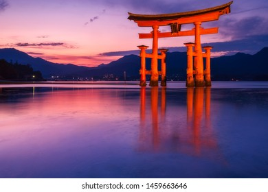 Long exposure image of the famous Torii Gate of Miyajima Island, Unesco listed Shinto Shrine at Sunset with the tide coming in, making it look like it is floating.(Translated text: Itsukushima Shrine)