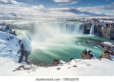 Long exposure image of the Godafoss waterfall under a blue sky