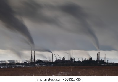 Long exposure image of industrial plant with smoke stacks, industrial area