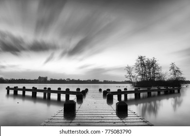 Long exposure image of lake and small jetty in Amstelveen, Netherlands