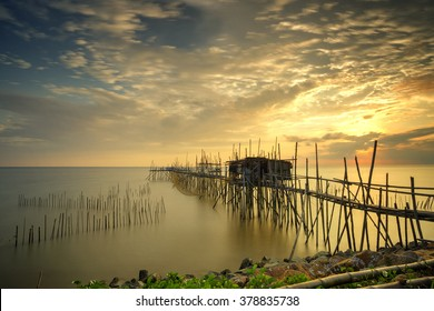 """Long exposure image of """"langgai"""" during beautiful sunset , the traditional fishing medium at Malaysia .Image has certain noise and soft focus when view at full resolution"""
