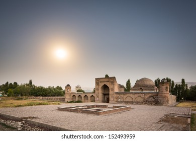 A long exposure image of Madrasa-e Kohna in Hisor (Hissar), Tajikistan. Kohna means old in Tajik, and Madrasa means school. The photo is taken at night, with the school illuminated by a full moon.