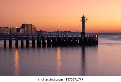 Long exposure image of the Nieuwpoort pier and lighthouse at sunset
