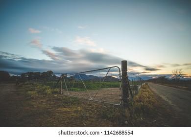 Long exposure image over an old farm gate on a farm