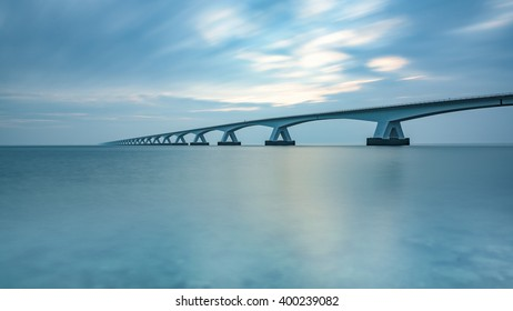 Long exposure image of the Zeeland bridge as seen from the south, just after sunrise