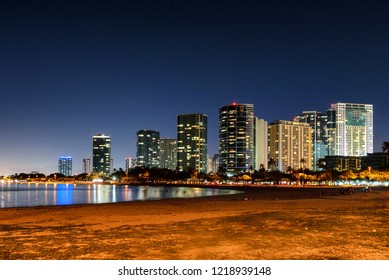 Long exposure of the Kakaako subdivision in Honolulu as seen from Ala Moana Beach Park at night