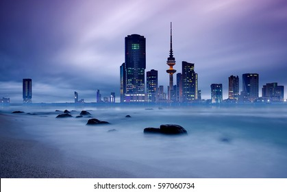 long exposure of kuwait city skyline during blue hour
