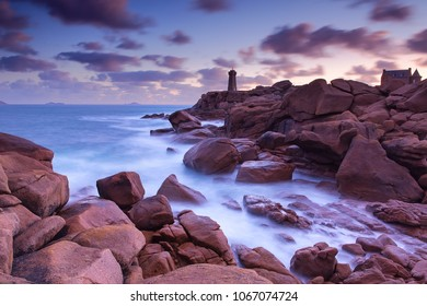 Long exposure of Lighthouse at sunrise in pink granite coast, Ploumanach, Perros Guirec, France.