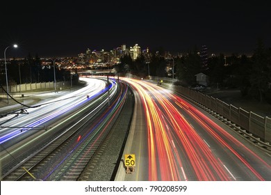 long exposure with lights of the cars and trains in the night