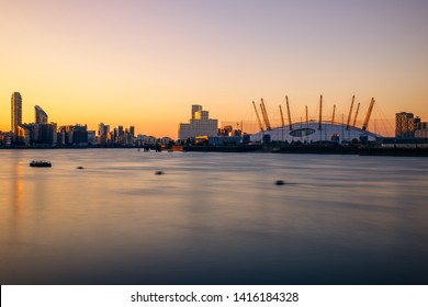 Long exposure, London cityscape with the O2 arena at sunset