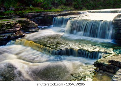 Long exposure of the lower part of Aysgarth Falls a cascade of small waterfalls with the sun shining on the water above