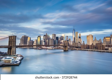 Long exposure of Manhattan Island with milky water and streaky clouds